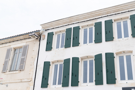 France Isle of Re old stone house with green shutters