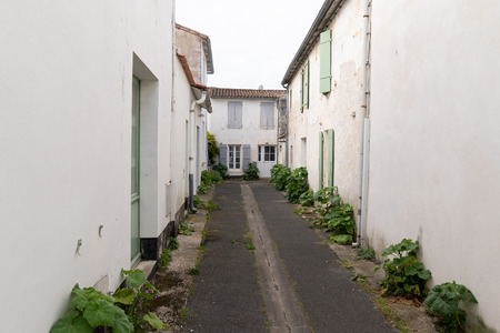 authentic little cobblestone street in Charentes maritime Re Island in French country Stok Fotoğraf