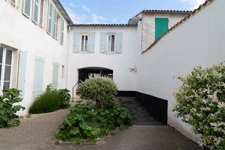 white house street in Re island village situated on Ile de Re, France