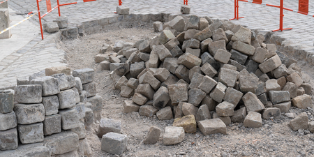pile of processed pieces of granite prepared for work on paving cobblestones street works Stockfoto - 122891532