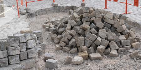 pile of processed pieces of granite prepared for work on paving cobblestones street works 版權商用圖片