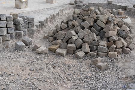 construction stone tiles for pavement granite cobblestone in street works Stockfoto - 122891534