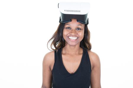 Smile young woman wearing using virtual reality VR glasses helmet headset on white background
