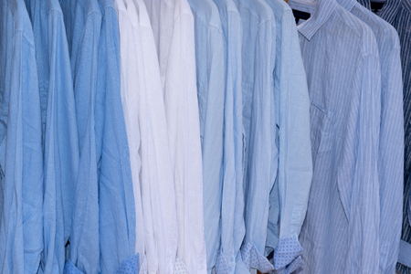 background of shirts blue and white hanging on a hanger