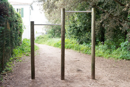 pull-ups on bar in city park empty in forest for sport exercise Stock Photo