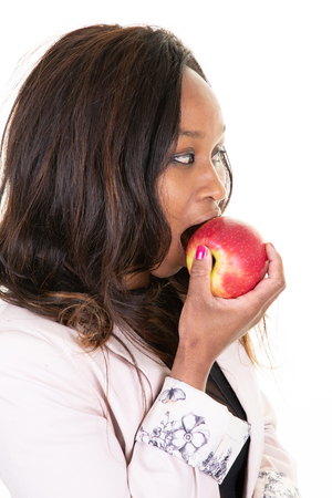 profile american african woman eating apple red on white background