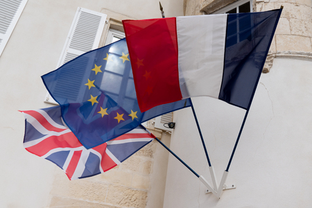 French uk English brexit and the European Union flag waving in the wind