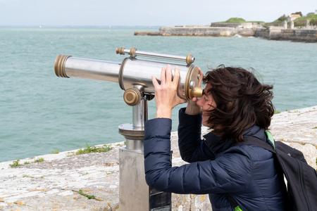 Woman Looking Through Telescope at Beach in island ile de Re in France Stock fotó