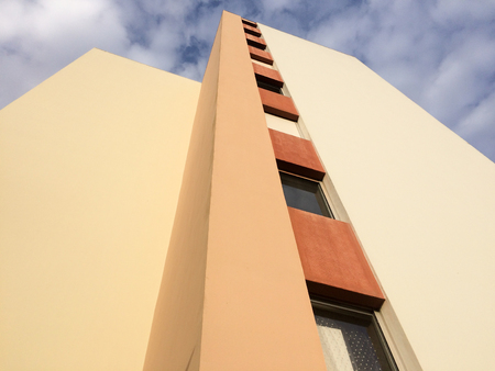 brown orange Yellow building with windows and blue sky Stok Fotoğraf
