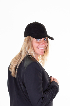 Beauty portrait of sensual blonde woman in business jacket suit and baseball cap