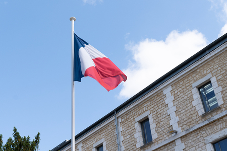 french flag at the top of a mat in a barracks blue white red