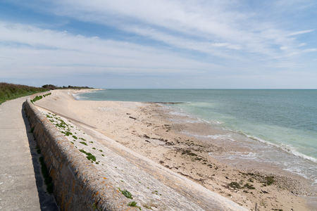 seaside protection dike against waves on island of Re in France with path  Sea and Breakwater
