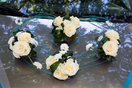 Bridal roses bouquet of flowers on car hood