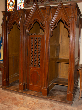 wood confessional in a catholic church