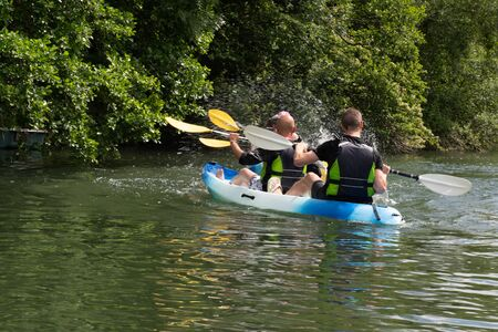 Tourists kayaking on river Clain at Poitiers in France