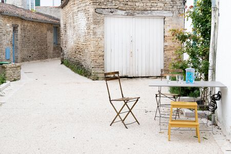 small place on the island of Ré in France with table and chair