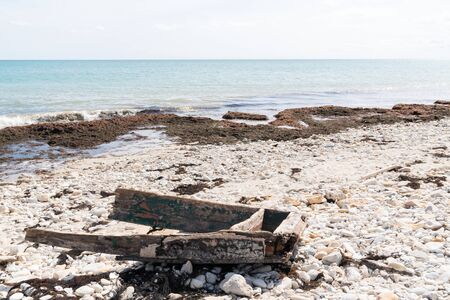 Ship wreck of small boat on a sandy beach