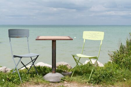 empty romantic table and chairs in ile de re in french country island