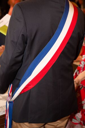 french tricolor mayor man scarf during celebration in france