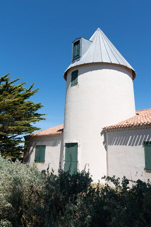 Beach windmill on the island of Noirmoutier in Vendee France
