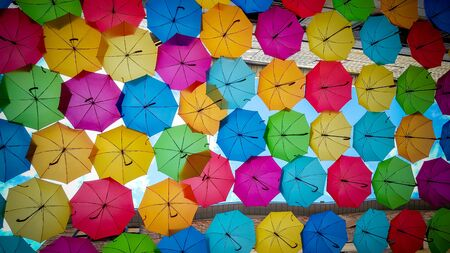 Street decorated with colored umbrellas background