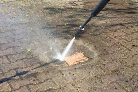 industrial cleaning concrete block floor by high pressure water jet Stok Fotoğraf