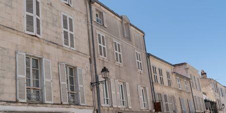 building in street city seaside of La Rochelle in France in web banner template