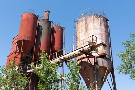 used rusty concrete plant abandoned in an industrial wasteland in Trentemoult village in France Reklamní fotografie