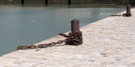 bollard for boat at the port in La Rochelle harbor France in web banner template header