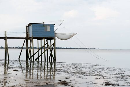 fishing huts on stilts at dusk in Fouras Aquitaine France Stock Photo - 128195958