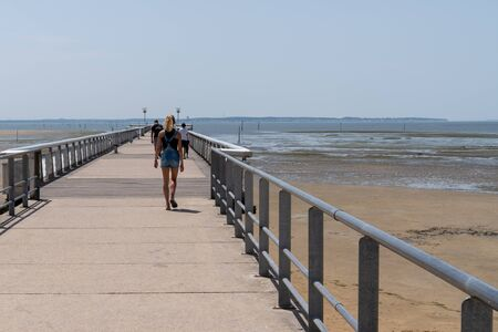 young girl back on the pontoon Pier of Andernos les Bains Stock Photo