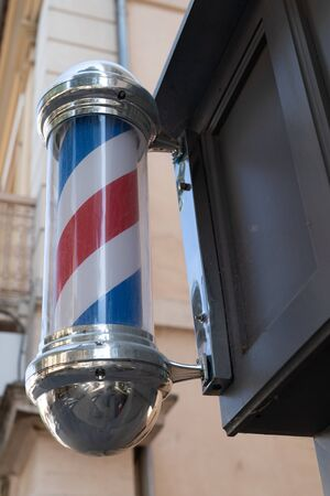 Street sign board pole barbershop building facade shop concept
