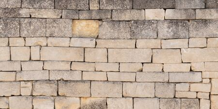 detail of an old city wall made of many different stones in Bordeaux France in web banner template header panorama