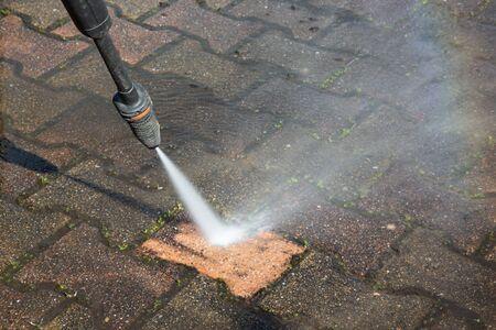 Outdoor floor sidewalk deep cleaning with high pressure water jet
