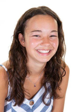 young beautiful teenage caucasian girl cute smiling looking at camera in studio white background Stock fotó