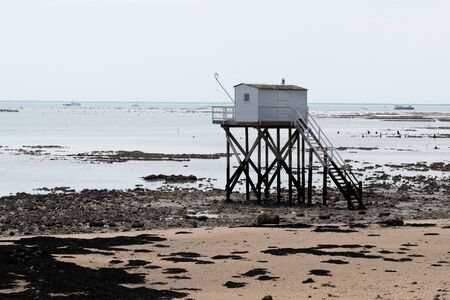 french sandy beach with isherman hut on the isle of Aix Charente maritime France