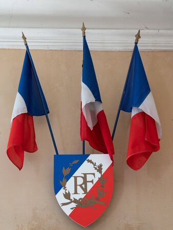 French flags and badge RF means French Republic in exterior of the city hall