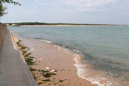 dike beach grey dam in Saint Vincent sur Mer in Vendée France Stock Photo