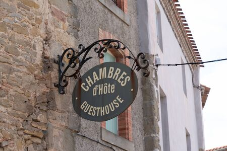 Chambre dhotes means guesthouse in sign street road on building Banco de Imagens