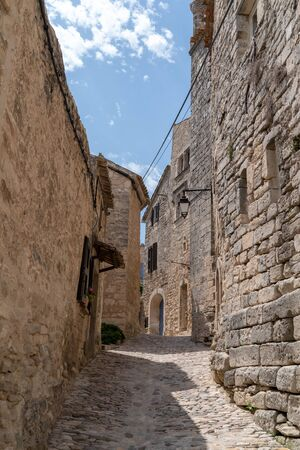 Lacoste in Provence small paved street going up in Luberon France Stock Photo