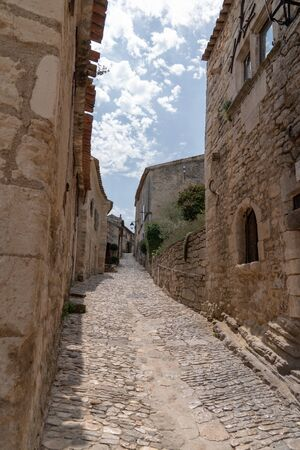 Paved street Village of Lacoste with old stone houses in Provence France Stock Photo