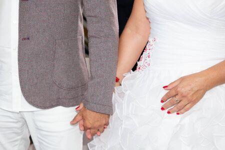 happy wedding day bride and groom hand together during celebration Stok Fotoğraf