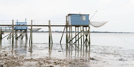 blue fishing huts on stilts at dusk in Fouras Aquitaine France