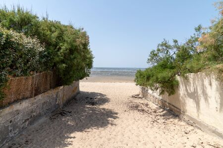 sand beach access to bassin dArcachon in southwest France city of Andernos