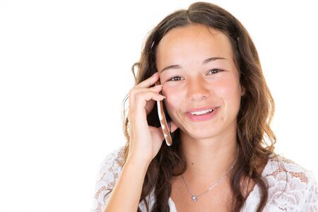 Portrait of happy brunette surprised young woman on white background teen girl on phone speak