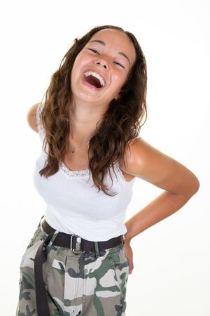 Young laughing girl against white isolated background