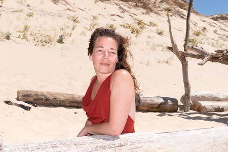 Summer portrait of beautiful woman near sand beach in vacation Zdjęcie Seryjne