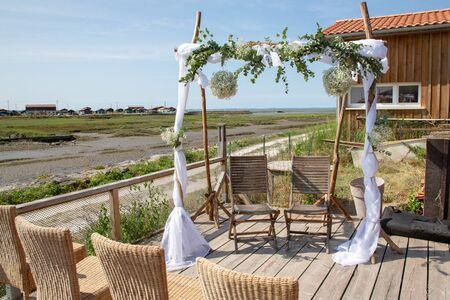 Romantic wedding ceremony on the coast sea view