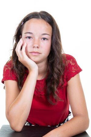 Young woman over white wall thinking an idea with hand on chin head Stock Photo