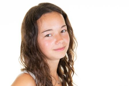 Head shot of young woman with beautiful face aside copy space looking at camera on white background Stock Photo